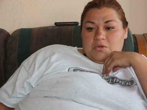 Мать четверых детей забеременела девятью. Фотографии